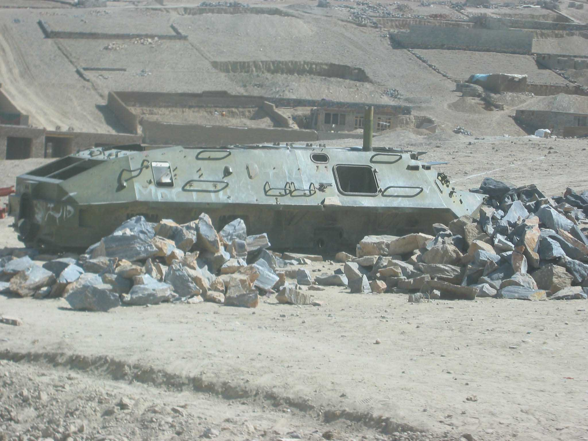 The hull of a Soviet BTR armoured personnel carrier is all that's left after locals in a village near Kabul strip it down for scrap